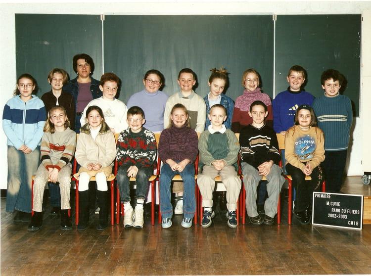 Photo de classe primaire cm1 b de 2002 ecole marie curie for L agence de rang du fliers