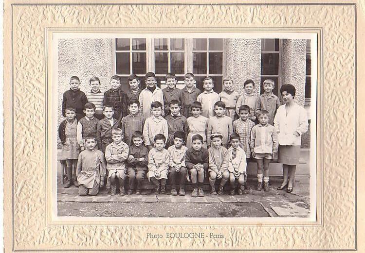 Photo de classe CE1 de 1960, Ecole Romain Rolland (Sainte Genevieve Des Bois) Copains d'avant # Auto Ecole Sainte Genevieve Des Bois