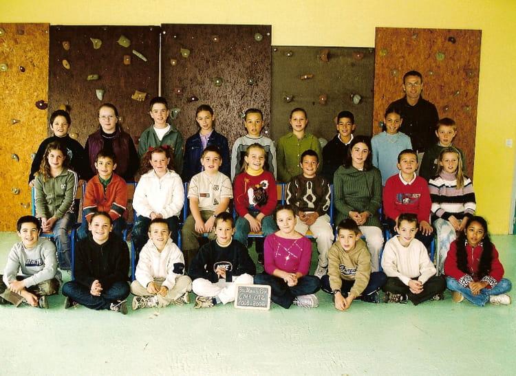 Photo de classe cm1 de 2003 ecole jacques prevert for Garage bailleau le pin