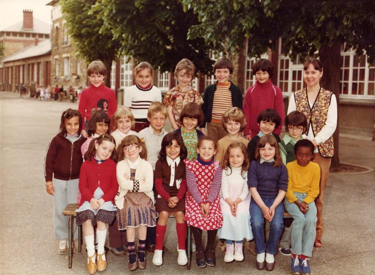 Photo de classe CP de 1981, Ecole Hippolyte Cocheris (Sainte Genevieve Des Bois) Copains d'avant # Auto Ecole Sainte Genevieve Des Bois